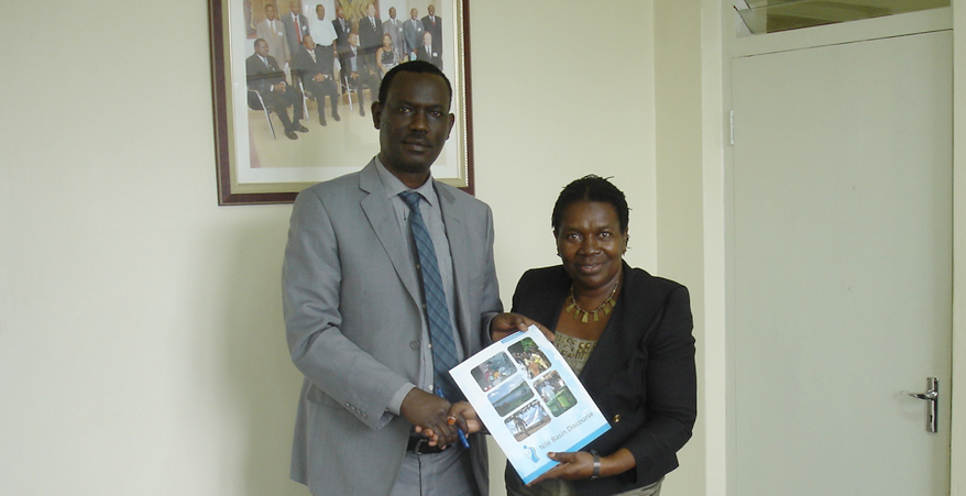 The NBI Executive Director Eng. Innocent Ntabana receives the welcome letter and the stakeholder mapping report from the NBD Regional Manager Dr. Hellen Natu